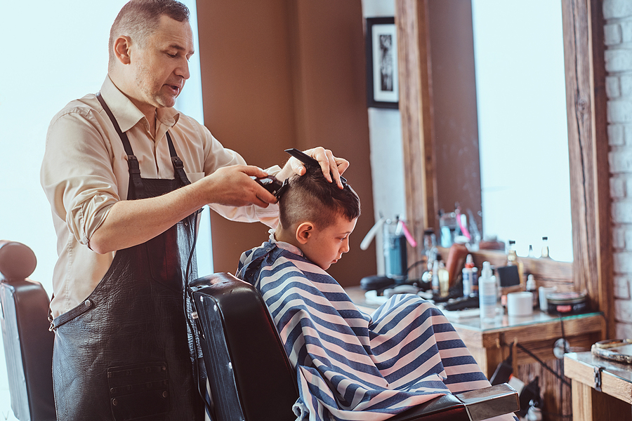 Child in barber chair (stock photo)