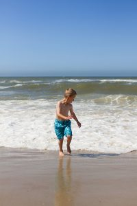 Child at beach on summer vacation (stock photo)